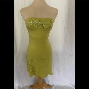 Form fitting green backless dress w/ sequence